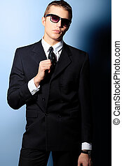 black tie - Portrait of a handsome young man in a suit. Shot...