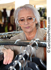 Elderly lady clothes shopping