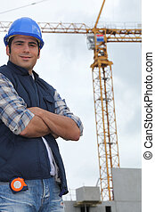 Construction worker in front of a crane