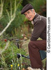 Elderly person watering flowers
