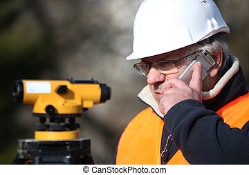Civil engineer with surveying equipment