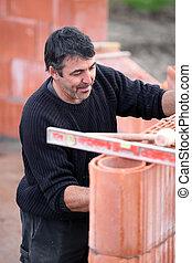 Stonemason constructing a wall