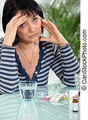 mature woman having a headache