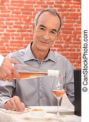 Man drinking wine in a restaurant