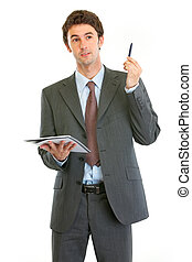 Modern business man with notepad and pen got idea