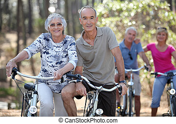 Mature couples on a double date biking