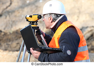 A land surveyor using an altometer