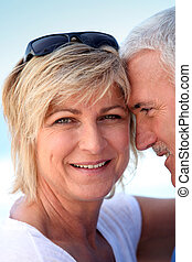 Middle-aged couple at the beach