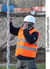 surveyor taking measurements