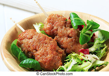 Minced meat kebabs - Rolled minced meat on stick and fresh...