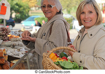 Mother and daughter shopping at the market together