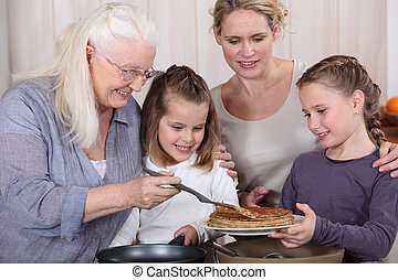 Three generations enjoying crepes