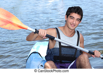 Young man smiling in a canoe