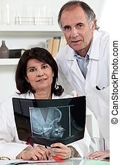 Two doctors examining x-ray image