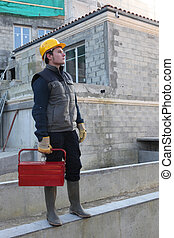 young craftsman outdoors in construction site