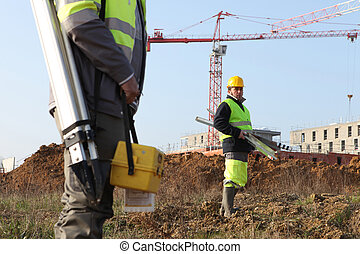 surveyors on a construction site