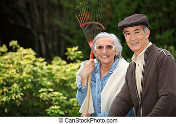 Smiling senior couple gardening