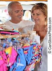 Couple clothes shopping