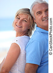 A mature couple at the beach.
