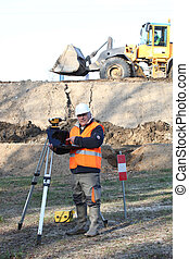 surveyor working on a construction site