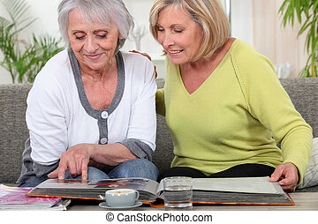 Older women looking at a photo album