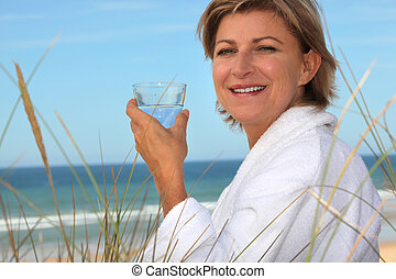 mid aged woman relaxing on the beach