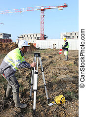 Civil engineers on site with surveying equipment