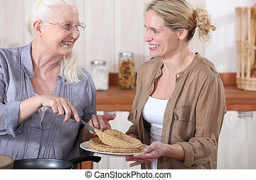 portrait of grandmother offering crepes