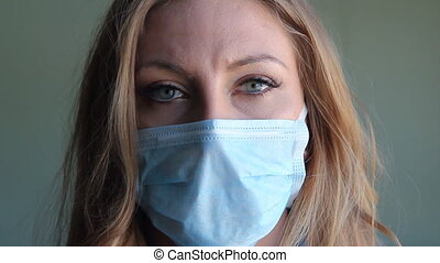 Girl with medical mask. - Young woman wearing a medical...