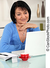 Woman reading an e-mail message
