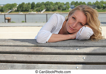 Woman sitting on a bench