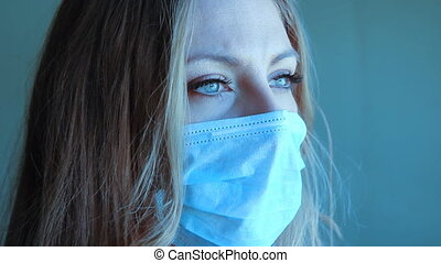 Girl with medical mask 2 shots - Young woman wearing a...