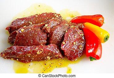 Elk steaks in marinade - Marinaded elk back strap steaks...
