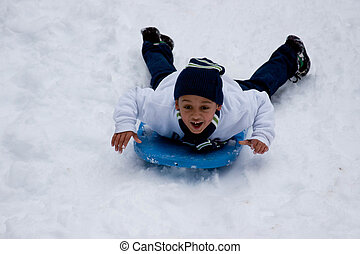 Boy Sledding Head First
