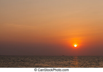 The sun goes down - The sun goes down at sea, the sky is...