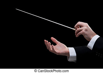 Conductor - Male orchestra conductor hands, one with baton....