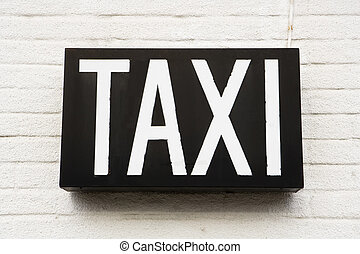 Taxi sign - Taxi Sign on a wall