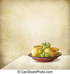 Tray with fruits on a table against a grunge wall