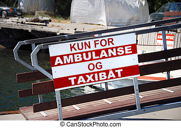 Ambulance and Taxiboat sign in Norwegian coastline