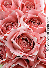 Close up bouquet of pink fabric roses.