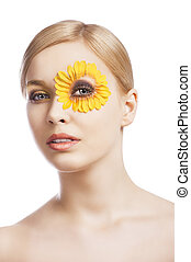 the floral makeup, she looks down, she looks in to the lens