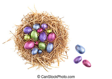 Straw nest with chocolate Easter eggs