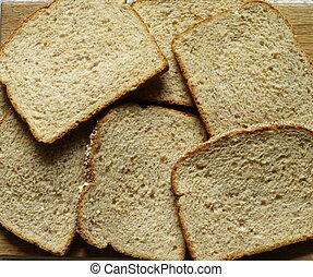 BREAD - A few slices of brown bread shown from above