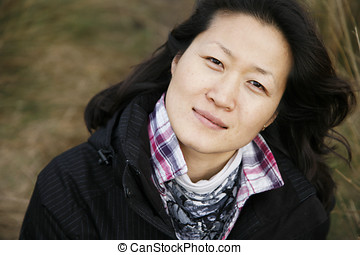 Portrait asian woman looking up camera in the field