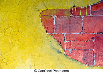 Yellow plaster and a red brickwall