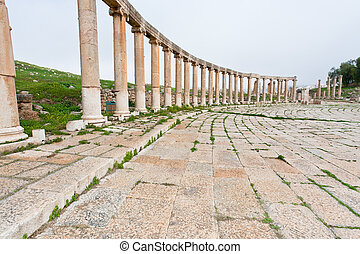 colonnade on the roman oval forum in antique town Jerash