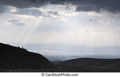 view on Dead Sea though mountain valley in cloudy evening