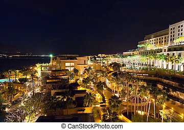 resort on Dead Sea at night - resort territory on Dead Sea...