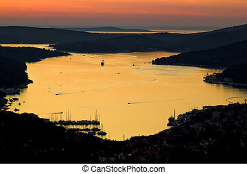 Island of Losinj bay reflection at sunset with boats,...