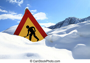 Under construction sign on snow - Under construction sign on...